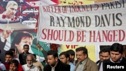 Pakistani protesters demand the death penalty for Raymond Davis in Lahore.