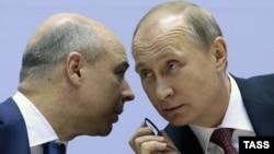 Министр экономики России Антон Силуанов и президент России Владимир Путин