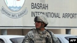 A U.S. soldier stands guard at the Basra International Airport.