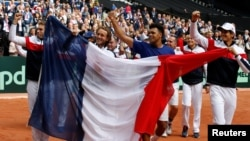France celebrates after defeating Serbia to advance to the Davis Cup finals against Belgium.