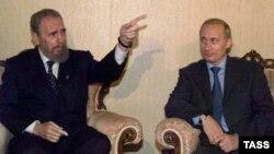 Fidel Castro și Vladimir Putin la misiunea rusă de la ONU, New York, 8 septembrie 2000