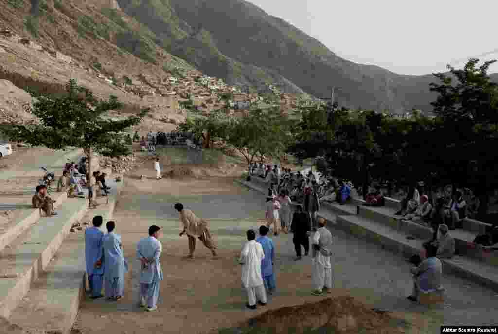 Hazara men play a round of Sang Girag in a Hazara enclave within Quetta.
