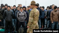 Georgian recruits line up for inspection at a military training center outside Tbilisi.