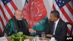 Afghan President Hamid Karzai (left) with U.S. President Barack Obama (file photo)
