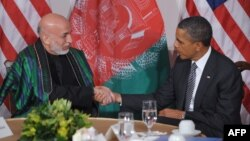 U.S. President Barack Obama (right) and his Afghan counterpart, Hamid Karzai, must also review and officially confirm the document.