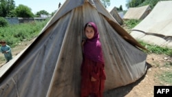 FILE: Hundreds of thousands of vulnerable Pakistanis depend on aid groups for essential services.