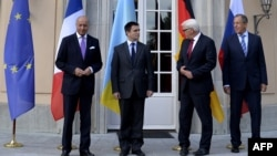 Лоран Фабіус, Павло Клімкін, Франк-Вальтер Штайнмаєр і Сергій Лавров під час зустрічі в Берліні 17 серпня 2014 року