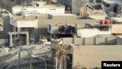 Iraq -- A general view shows damaged houses in the city of Ramadi July 30, 2014.