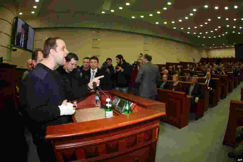 Leader of pro-Russian activists Pavel Gubarev shouts at deputies of the regional council after protesters broke into the hall during session in Donetsk on March 3. (AFP/Aleksandr Khudoteply)