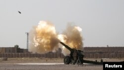 Iraqi forces fire artillery toward Islamic State militants near Fallujah on June 1.
