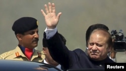 Pakistani Prime Minister Nawaz Sharif waves after attending the Pakistan Day parade in Islamabad on March 23.