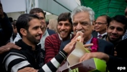 Zafar Iqbal Jhagra, a senior leader of ruling Pakistan Muslim League Nawaz (PML-N) celebrate his victory after he won a seat in the Senate.