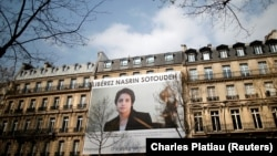 A banner with a giant portrait of jailed Iranian lawyer Nasrin Sotoudeh is seen on the headquarters of the French National Bar Council, demanding her release, in Paris, March 28, 2019