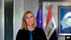 European Union foreign policy chief Federica Mogherini holds a press conference with Iraqi Foreign Minister Mohamed Alhakim after their meeting at the Ministry of Foreign Affairs in Baghdad, Iraq, Saturday, July 13, 2019. (AP Photo/Hadi Mizban)