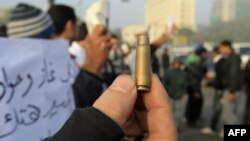 Egypt -- A protester shows a spent bullet casing during a demonstration onTahrir Square in Cairo, 19Dec2011