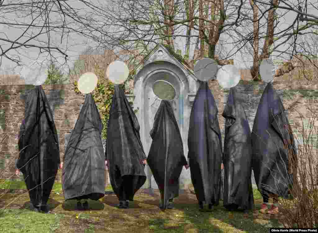Women in costumes -- which they say represent Ireland's treatment of women -- line up before marching silently through the streets of Limerick, Ireland. It was part of an appeal to change the law against abortion. Contemporary Issues: First Prize, Stories - Olivia Harris
