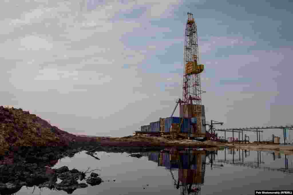An abandoned oil well and waste from drilling near the herding grounds
