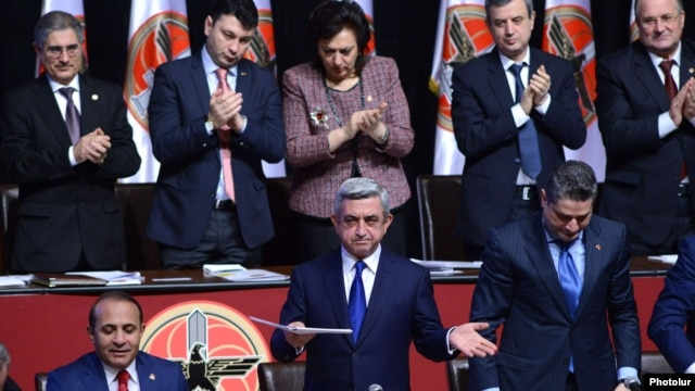 "Armenian Serzh Sarkisian, seen gesturing to delegates at the congress of his Republican Party of Armenia that endorsed him in December, insisted in an RFE/RL interview that ""nurturing"" the opposition is not his job."