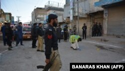 FILE: Pakistani police guard the site of a shooting incident in Quetta.