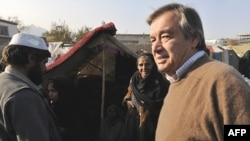 UN High Commissioner for Refugees Antonio Guterres (right) inspects a camp for displaced Afghans in Kabul last November.