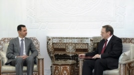 President Bashar al-Assad meets with senior Russian envoy Mikhail Bogdanov in Damascus on August 29.