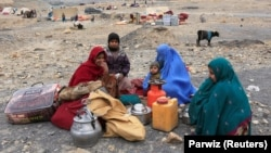 AFGHANISTAN -- Internally displaced Afghan family, who flee from recent conflict, take shelter at a desert in Khogyani district of Nangarhar province, November 28, 2017