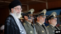 """Iran's Supreme Leader Ayatollah Ali Khamenei delivering a speech on October 5 at the Military College of Tehran where he described the United States government as """"untrustworthy."""""""