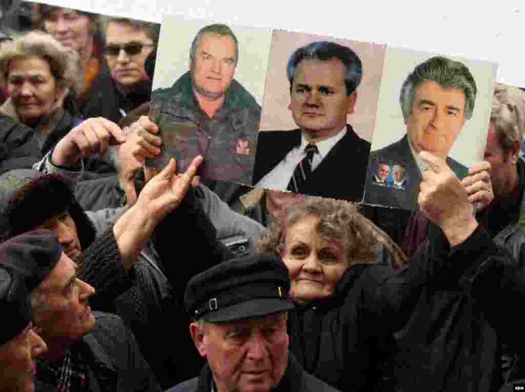 A Kosovar Serb holds pictures of Mladic, Milosevic, and Karadzic during a 2007 protest against independence for Kosovo - But not everyone in the former Yugoslavia has welcomed the news. Some militant Serbian nationalists continue to regard Karadzic as a hero and an icon of Serbian unity, along with late Yugoslav leader Slodoban Milosevic.