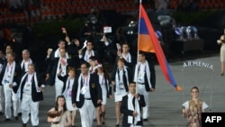 U.K. -- Armenia's flagbearer Arman Yeremyan (2ndR) leads his delegation during the opening ceremony of the London 2012 Olympic Games, 27Jul2012