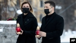 Ukrainian President Volodymyr Zelenskiy and his wife, Olena, pay their respects at the so-called Monument of the Heavenly Hundred inKyiv's Independence Square (Maidan Nezalezhnosti) on February 20.