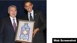Kazakh President Nursultan Nazarbaev gives his U.S. counterpart Barack Obama the special gift in a frame.