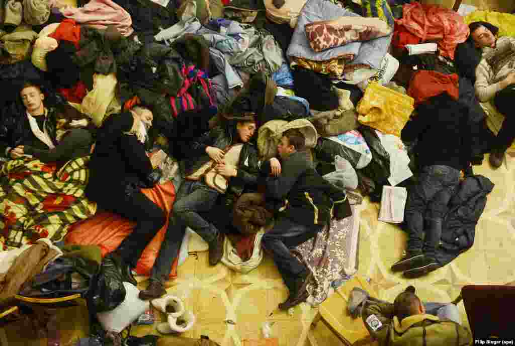 Occupying protesters sleep inside Kyiv's City Hall.