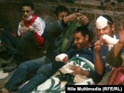 محتجون مصابون في ميدان التحرير بالقاهرة