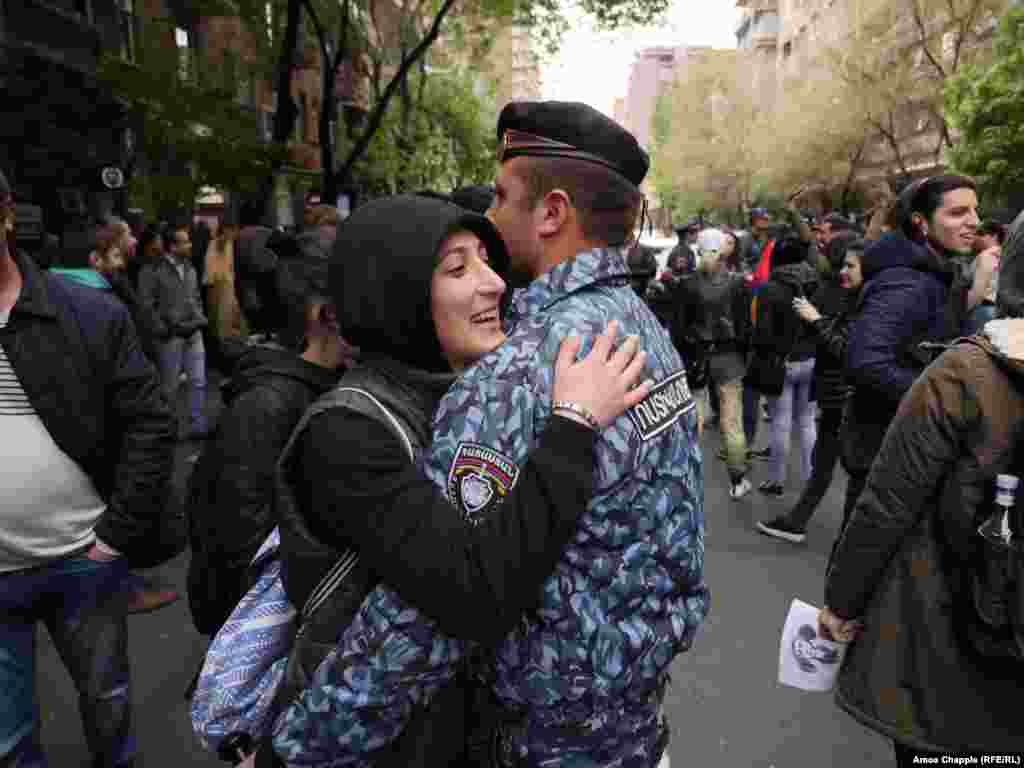 Protesters blocked a central crossroad in Yerevan. Around 60 police armed with nightsticks tried to hem them in, but with mostly young women in front, the police eventually gave up and retreated to a nearby courtyard.