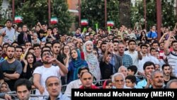 People gather in the city center of Rasht to watch the Iran-Morocco match on June 15.