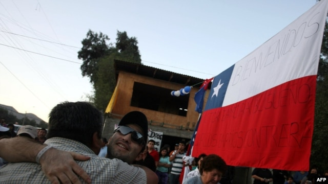 Carlos Barrios, one of the 33 rescued San Jose miners, hugs a friend on his return home in Copiapo.