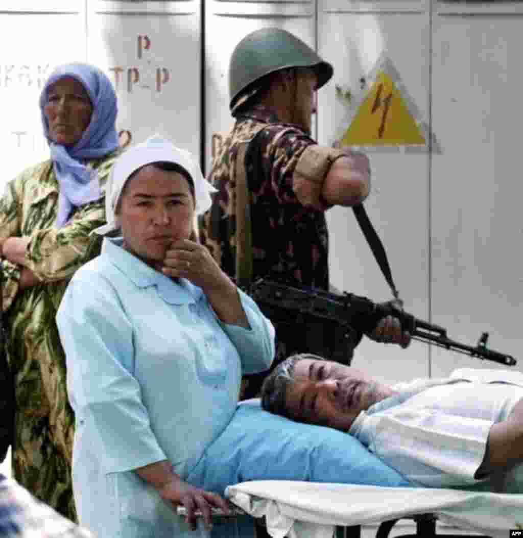 A nurse waits with an injured patient at a hospital in Andijon on May 14 - What's clear is that Uzbek security forces fired on a large crowd of protesters gathered in the central square of Andijon.