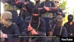 Вооруженные боевики предположительно из стран Центральной Азии, отправившиеся на «джихад» на Ближний Восток. Скриншот видео, опубликованного в Сети.