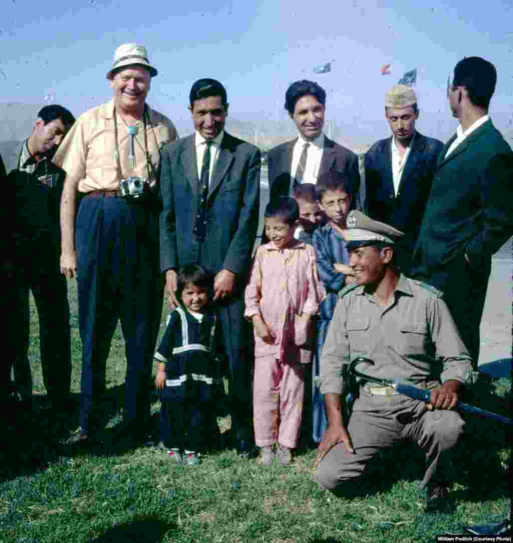 "Of her father, Dr. William Podlich (second from left), Peg Podlich said: ""He had always said that since he had served in WWII...he wanted to serve in the cause of peace. In 1967, he was hired by UNESCO as an expert on principles of education for a two-year stint in Kabul.... Throughout his adult life, because he was interested in social studies, whenever he traveled around [in Arizona, to Mexico, and other places] he continued to take pictures. In Afghanistan he took half-frame color slides [on Kodachrome] and I believe he used a small Olympus camera."""