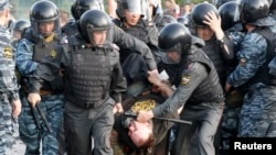 Riot police detain a protester during an opposition rally in Moscow. (file photo)