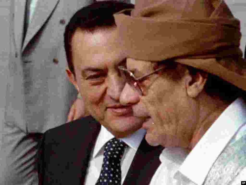 Qaddafi chats with Egyptian President Hosni Mubarak upon his arrival in Cairo on June 22, 1996, to attend an Arab Summit. Mubarak was himself ousted as president by antigovernment protests in February and is now on trial in Cairo.