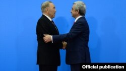 Kazakhstan - President Nursultan Nazarbayev greets his Armenian counterpart Serzh Sarkisian at the Eurasian Union summit in Astana, 29May2014.
