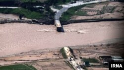 Floods in Iran's Lorestan Province swept away a road bridge in early April.