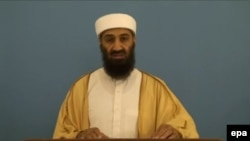 A grab from a video provided by the CIA titled 'Despotism of Big Money' recovered during the 2011 raid on al-Qaeda leader Osama bin Laden's compound in Pakistan, shows Bin Laden speaking.