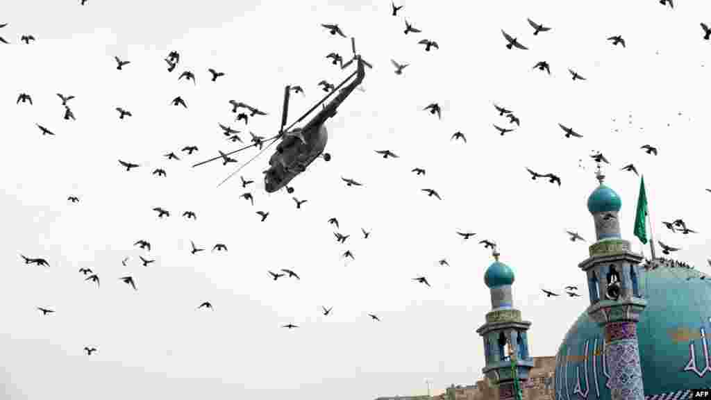 An Afghan National Army helicopter flies over the Sakhi Shrine in Kabul.