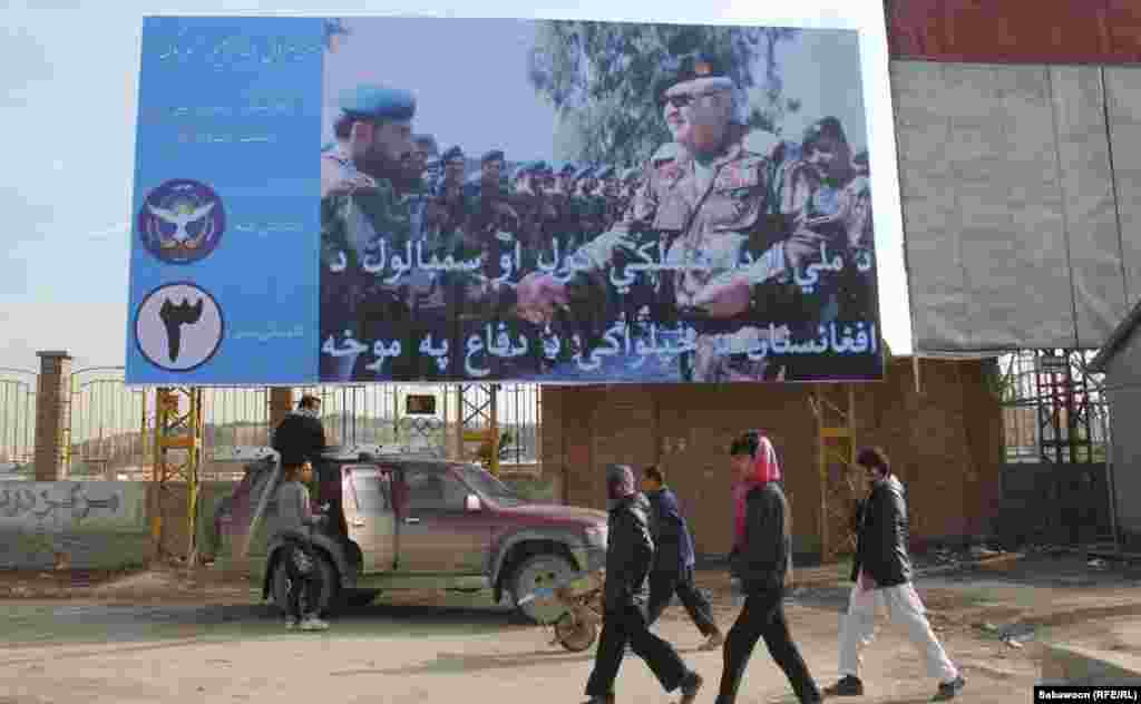 Former Afghan Defense Minister General Abdul Rahim Wardak displays his military background to lure voters.