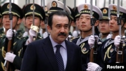 Кәрім Мәсімовтің премьер-министр кезіндегі суреті. Пекин, Қытай, 31 наурыз 2012 жыл.