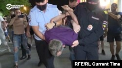 Police detain a protester following a scuffle during a rally in Khabarovsk on July 26.