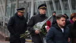 Mourners arrive for a farewell ceremony in Kyiv on January 19 for the Ukrainian victims of Flight PS572, which was shot down over Tehran last week, killing all on board.