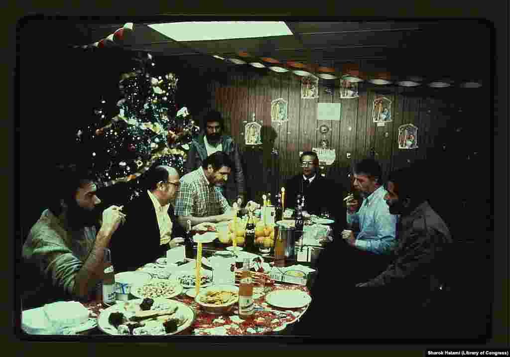 The American hostages are shown on Christmas Eve 1979. Hundreds of cards sent from well-wishers in the United States were delivered to Iranian guards, who promised to hand them over to the hostages after inspection, but never did.